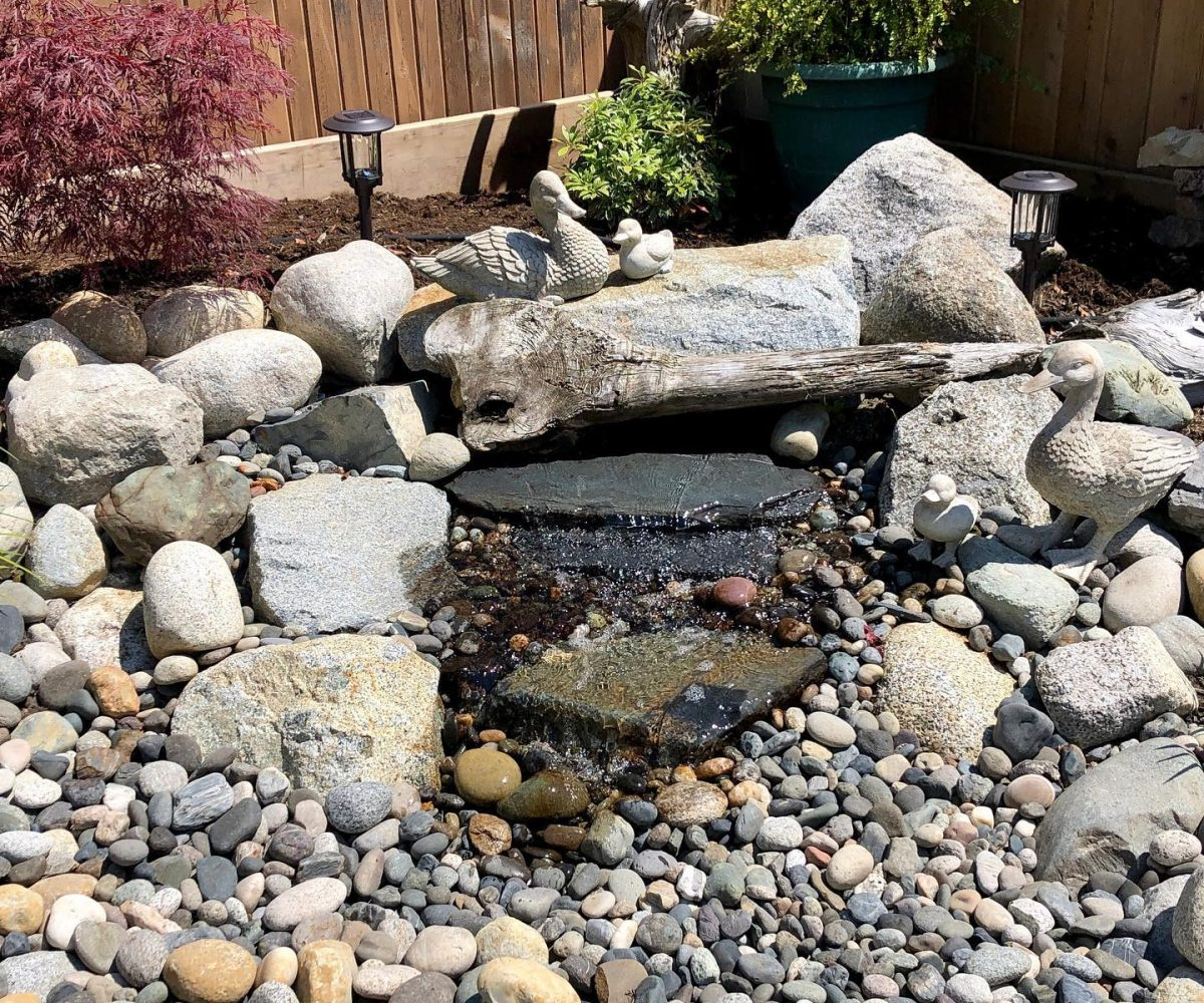 Landscape contractor water feature installation